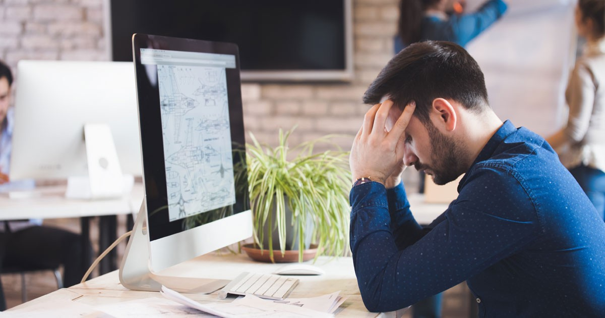 Worried Employee at Computer Facing the Pressure and Stress of an Upcoming Deadline